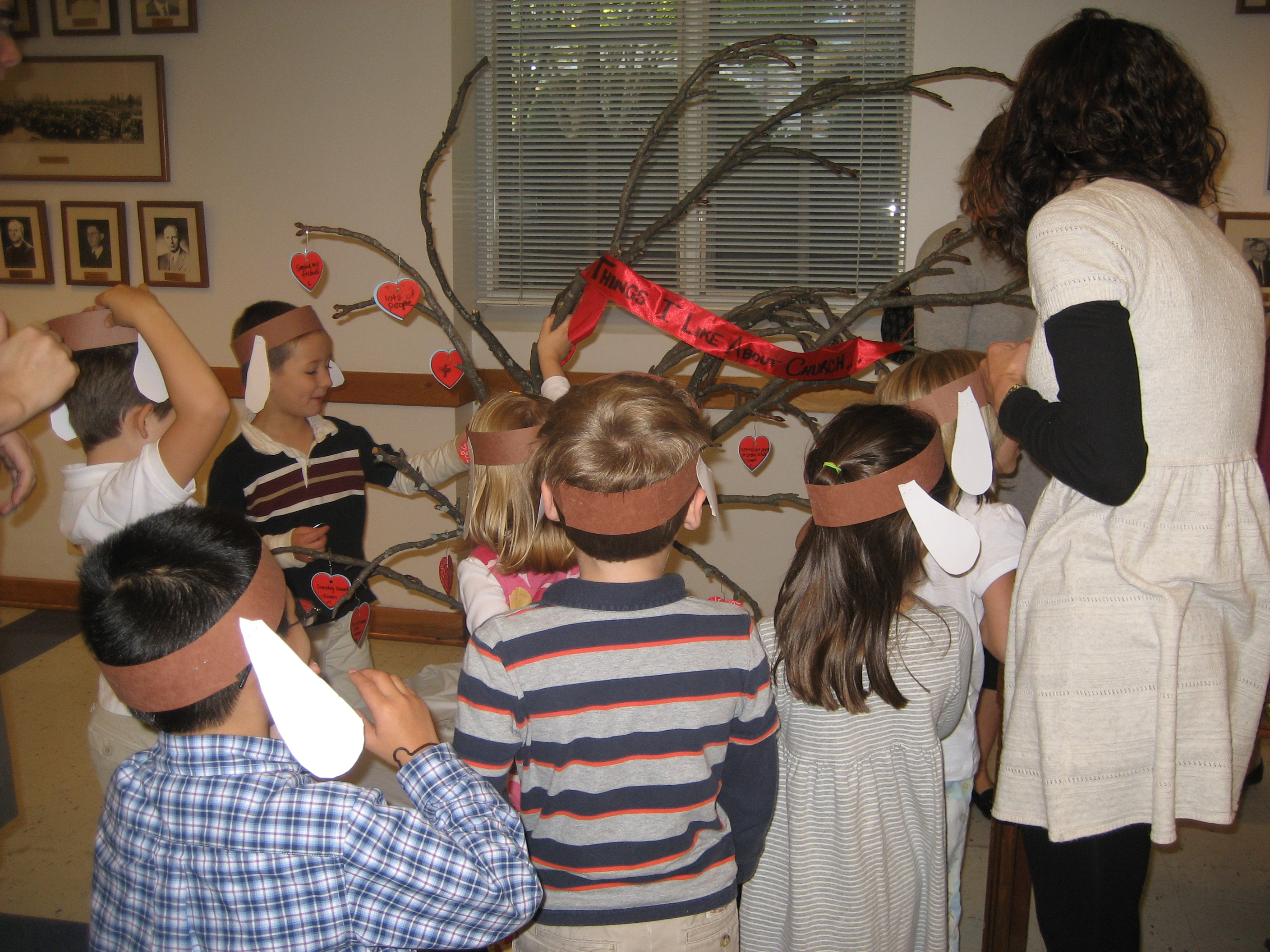 Children decorate the Heart Tree